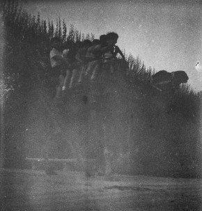 A badly damaged negative of a Camel ride
